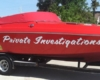 red boat with lettering